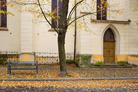 Side door of Gothic church in Zatec town. Autumn. Czech Republic.