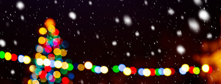 Christmas tree in the snowfall by night