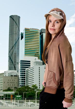 Girl in front of buildings in Brisbane. Australia.