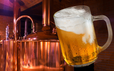 Glass of beer in the brewery. Imagens