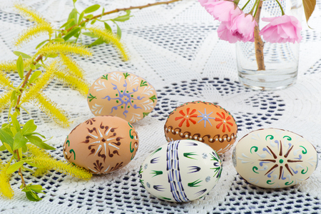 Painted Easter eggs with a blossom on the desk