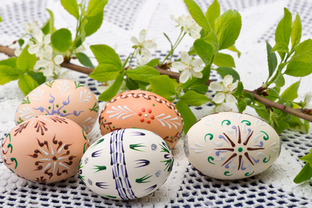 Painted Easter eggs with a twig on the desk 写真素材