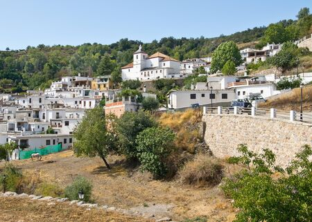 BUSCUISTAR, SPAIN - SEPTEMBER 10, 2019: Sunny day in Busquístar; Busquístar is a small village located in the Alpujarra mountain range in Spain