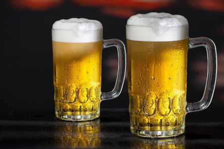 Two glasses of beer on the dark background Reklamní fotografie