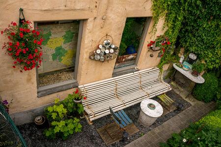 flemish: Bruges back garden and bench taken in Bruges, Belgium