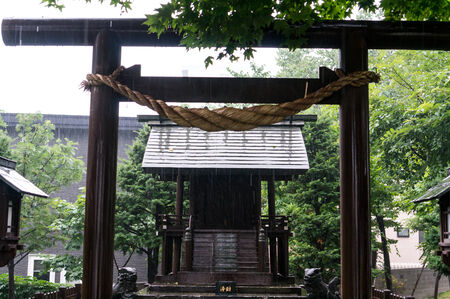 rain japan: Pouring rain over a shinto shrine in Sapporo, Japan