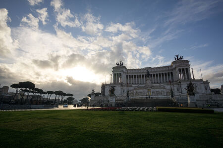severe weather: National Monument to Victor Emmanuel II taken under a stormy sky in the sunrise.