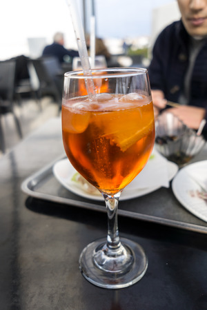 spritz: A glass of cold aperol spritz in an italian cafe. Stock Photo