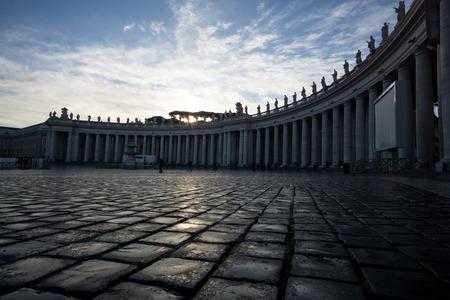 Vatican city plaza columns during sunrise. Фото со стока
