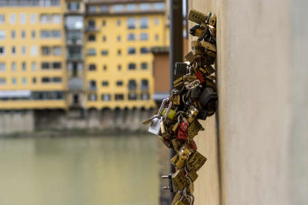 ponte vecchio: Locks hanging out from ponte vecchio in florence, italy. Stock Photo