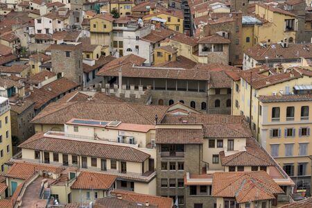 rooftile: Florence red bricks and traditional architecture viewed from on top of Vecchio tower.