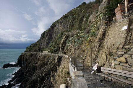 amore: parts of via dell amore closed with the gates locked viewed from Riomaggiore train station. Stock Photo