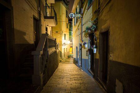 Small narrow riomaggiore alleyway taken at night. Stock Photo