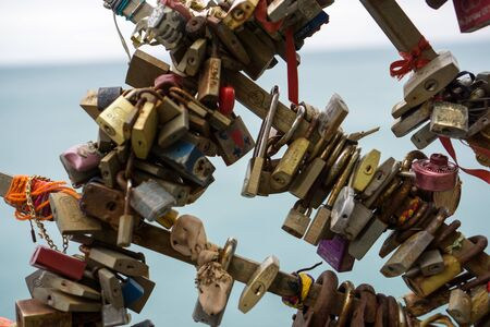 amore: locks on one of the gates on via dell amore in riomaggiore, italy.