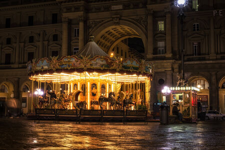 Merry go round lit up in Piazza repubblica in Florence, Italy Stock Photo