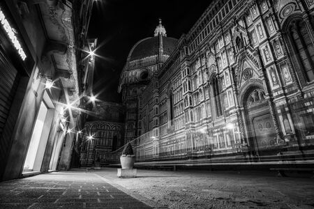 opening up: Duomo viewed from the street in the early morning when the shops are opening up. Stock Photo