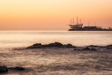 Sunrise view over the beach of Jeongdongjin in Gangneung, South Korea with the view of the famous boat shaped yacht club off the coast. Stock Photo