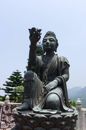 gautama buddha: the statues of buddhist religious statues in tian tan buddha on top of ngong ping plateau in lantau island in china. Stock Photo