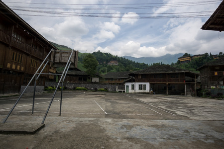 local chinese school yard with a basketball court in the center.  Taken near longji Rice terrace in china