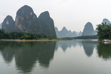 the famous 20 yuan banknote scenery taken early in the morning when the li river is calm. Taken in xingping, guilin, china. During summer.