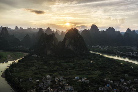 karst: The view of sunset from laozhai shan in near xingping, guangxi, china. Taken during hot summer. xingping is near yangshuo. The view of karst mountains and hill tops.