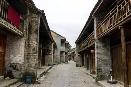 Traditional xingping old town village in guangxiprovince near yangshuo in china. Morning street view through the xingping village. Stock Photo