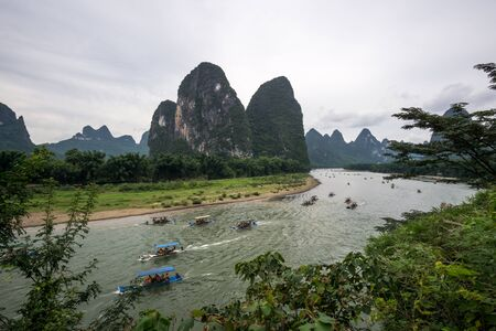 rmb: The tourboats near xingping 20 yuan rmb banknote on the li river, guilin, china. Taken during hot summer from the lookout point.