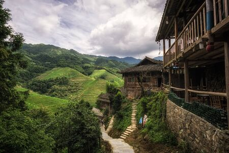 tou: a little pathway through tian tou zhai village in longji rice terrace, china. Stock Photo