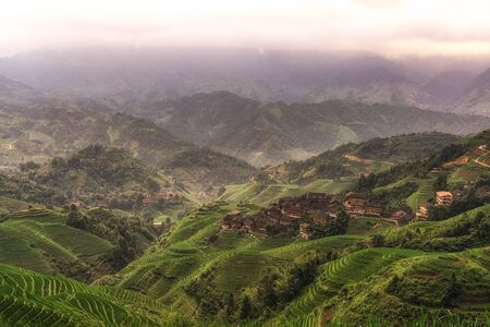 tou: Tian Tou Zhai village viewed from the viewpoint number 1 music from paradise in Longji rice terrace, China
