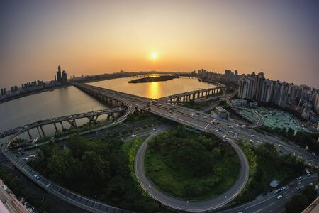 turnabout: Mapo bridge view from top of a building, sunset shining on the traffic during rushhour in seoul, south korea