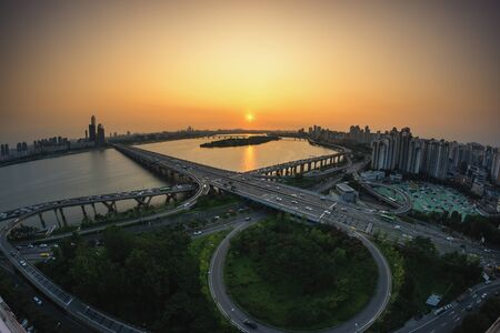 turnaround: Mapo bridge view from top of a building, sunset shining on the traffic during rushhour in seoul, south korea