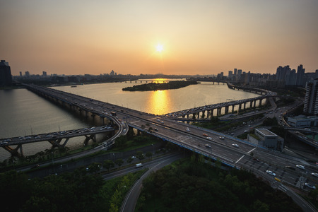 turnaround: mapo bridge view from top of a building, sunset shining on the traffic during rushhour in seoul, south korea Stock Photo