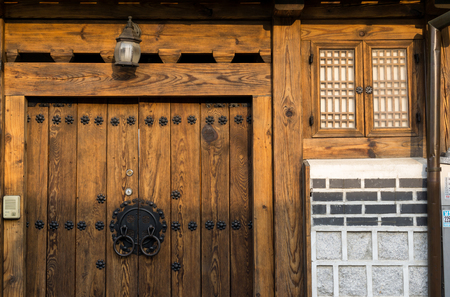 Traditional korean house front gate with the sunset light. Taken in Wonseo dong, south korea.