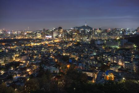 viewpoints: Inwangsan mountain night view over seoul from one of the main viewpoints near the mountain trails. Taken during a smoggy night. N seoul tower and namsan in the distance. Stock Photo