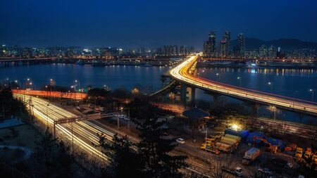 gangnam: Rush hour time over the cheongdam bridge in seoul, south korea. cheongdam bridge connects the gwangji and gangnam districts. Taken during winter when the Han river is partly frozen.