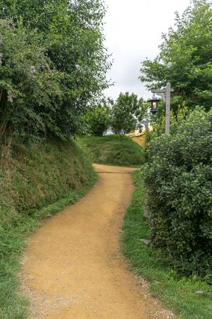 a small pathway and lanterns leading to movie set in new zealand. Taken in summer.