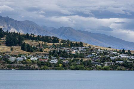 kelvin: lake wakatipu view with a small town across the lake. Taken near queenstown in new zealand. Summer lake wakatipu view.