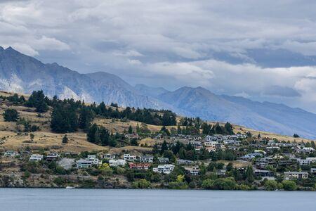 wakatipu: lake wakatipu view with a small town across the lake. Taken near queenstown in new zealand. Summer lake wakatipu view.