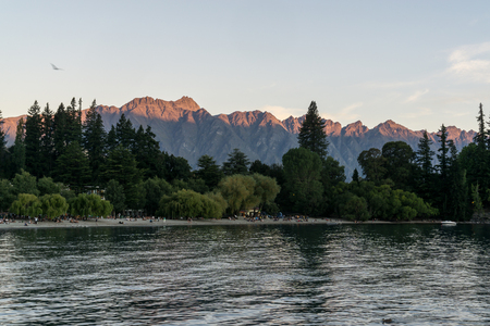 wakatipu: sunset view over remarkables in queenstown over lake wakatipu. Taken during summer in New Zealand.