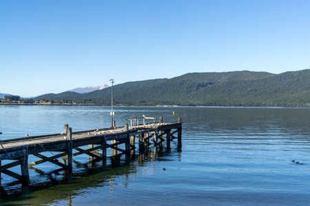 te: te anau lake view with sea gulls on the dock. Te anau, new zealand. Taken in summer.