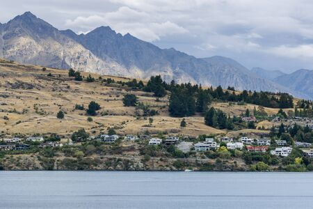 kelvin: lake wakatipu view with a small town across the lake. Taken near queenstown in new zealand. Summer lake wakatipu view.