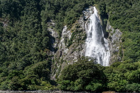 fiordland: Milford sound taken from the cruise boat. Various waterfalls along the valley. Taken in New Zealand during summer.