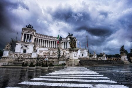 altar of fatherland: Altar of the Fatherland taken under a stormy sky in the morning. The famous landmark is lcoated in Rome, Italy. It was amazing to see stormy cloud over such a dramatic looking architecture. Taken last winter 2015