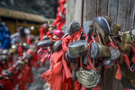 locket: red ribbons and lock in the shrine of tianmen cave. Zhangjiajie, china Stock Photo