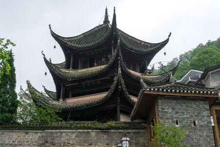rooftiles: winged tips of traditional pagoda roof style in fenghuang, china.