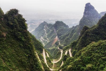 the view of tianmen mountain winding road from the tianmen national park walkways. Taken in zhangjiajie, hunan province, china Stock Photo