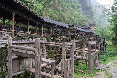 watermills: gallery of watermills in front of huanglong cave entrance area in zhangjiajie, china