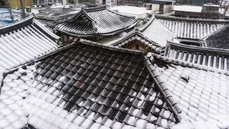 rooftiles: bukchon hanok village taken in winter viewed from the bukchon observatory in seoul, south korea Stock Photo