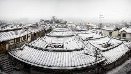 rooftiles: panoramic view of bukchon hanok village covered in snow. Taken in Seoul, South Korea Stock Photo