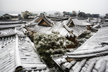 rooftiles: bukchon hanok village and a backyard tree taken in winter viewed from the bukchon observatory in seoul, south korea Stock Photo
